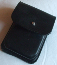 A black card case with a nickle sam brown fitting